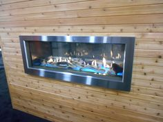 brand new indoor/outdoor linear gas fireplace from Town & Country (Pacific Gas) with illuminated interior, driftwood and glass media and brushed stainless steel exterior trim. Seen at #HPBEXPO indoor outdoor gas fireplace, outdoor fireplac, gas fireplaces, linear fireplac