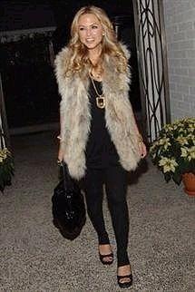 Love the fur vest.