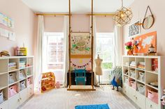 Cheerful kids playroom with swing