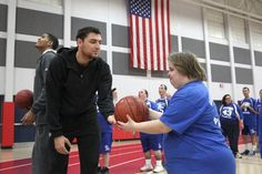 The Milwaukee Bucks players, coaches and mascot Bango host a basketball clinic for 200 Special Olympics athletes and their coaches at Homestead High School. The annual clinic is part of the long-standing support of Special Olympics by the Bucks organization.