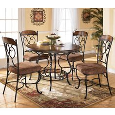 Nola Round Table w/4 Side Chairs by Ashley Furniture, D316-225. Furniture XO