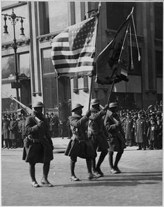 Colors of The Famous 369th Infantry in Parade in New York City. by The U.S. National Archives, via Flickr