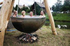 Looks like an SCA blacksmithing project/hot tub gone weirdly awry.  Mmmm, human soup! 0_o;
