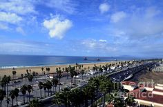 http://fineartamerica.com/featured/magic-clouds-at-huntington-beach-clayton-bruster.html