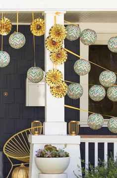 Decorate the front porch with a cluster of patterned paper lanterns!