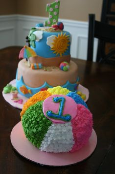 beach ball cake(on the right) for 1 year old birthday cake smash pictures on the beach!