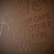 I'm a huge fan of cheap materials that look awesome (thus, my fixation on dollar store crafts), and thumbtacks are the kind of material that can swiftly be promoted from lowly office supply to design element. I love this typographical wall treatment by Jessica Hische. It took her 1000 thumbtacks, an afternoon, and hand-sketched typography on a wall.