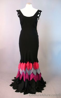 1930's Black crepe bias cut evening gown features an incredible flared mermaid hem.
