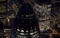 """The financial district, featuring the tip of 30 St. Mary's Axe, known by the nickname """"The Gherkin"""". (© Jason Hawkes)"""