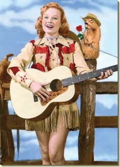 Vintage western singer in fringed skirt and western jacket, vintage westernwear