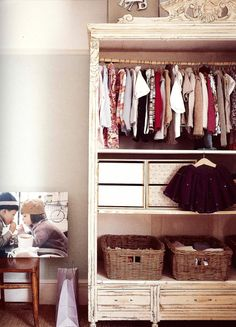 Take doors off old wardrobe and paint to make baby's closet