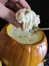 Bacon Jalapeno Dip baked in a pumpkin.  Yum!