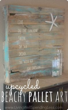 Upcycled beachy pallet art.  Beautiful (and practically free) art project made from an old pallet.  Worth checking out just to see the cool technique for making letters using fabric paint!