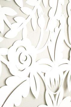 DIY Papercut Leaves Backdrop http://ruffledblog.com/diy-papercut-leaves-backdrop #diyproject #diy #weddingdiy