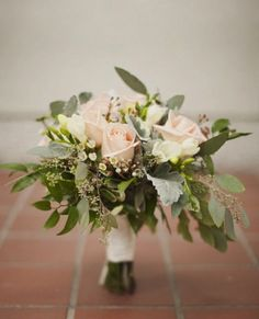 seeded eucalyptus, dusty miller are a nice filler here and makes your overall costs lower. You can then add in a peony and a couple garden roses which will be the bulk of the cost. Obviously you want yellow in it. I just wanted to show you the eucalyptus ;)