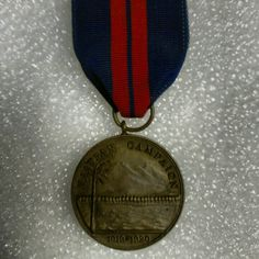 "This Second Haitian Campaign medal was issued to an aggressive young Marine NCO.  As a corporal, Lewis B. Puller received orders to serve as a lieutenant in the Gendarmerie d'Haiti.  He participated in over forty engagements.    The First Haitian Campaign medal looks very similar to the second, but the date on the obverse reads ""1915"" where the second reads ""1919-1920.""   Semper Fidelis  #USMC #USA #NMMC #USMCmuseum #Marines #Haiti #HaitianCampaign #Gendarmerie #BananaWars #ChestyPuller #SemperFi"