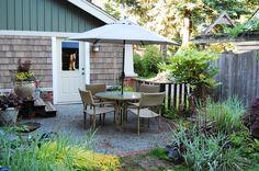 brick base, gravel patio, back doors, pea gravel, patio garden