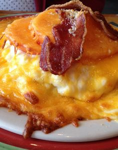 Recipe for Kentucky Hot Brown Sandwiches - It's Kentucky Derby day! And for those of us who can't make it all the way to Louisville, there is another way we can celebrate. We can down this mountain of awesomeness that comes straight from Derby Town! Bacon, cheese, gravy; what is not to love?!
