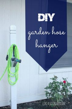 DIY Garden Hose Hanger - customize to fit your home!  Paint, add solar light top, etc.  Cheaper than a hose reel and it's pretty! :) #bestofbloggers