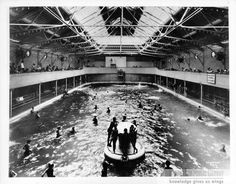 Long Beach, 1924. Shows The Plunge swimming pool at the Pike with many swimmers, as well as the crowd in the upper observation deck. For information about copyright and ordering images from the LBPL Digital Archive, see http://www.lbpl.org/history