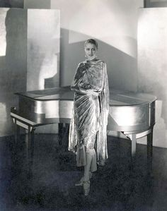 Marion Morehouse wearing a dress by Chéruit and jewelry by Black, Starr and Frost, next to a piano designed by Steichen, 1928. Steichen. Gelatin silver print. Courtesy Condé Nast Archive, New York. © 1928 Condé Nast Publications
