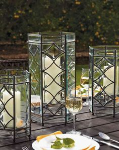 Candlelight flickers with mesmerizing, star-like quality inside our hexagonal Marquee Hurricanes.