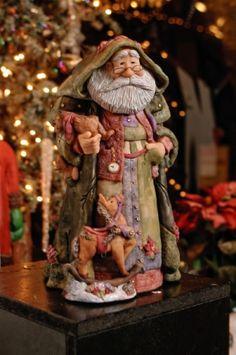 Santa figurines by Dennis Brown Artist