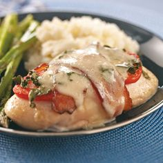 Caprese Chicken & Bacon - (make sure you use smoky real bacon...the salty smoky taste is unreal) Smoky bacon, fresh basil, ripe tomatoes and gooey mozzarella top these appealing chicken breasts. The aroma as they bake is irresistible!
