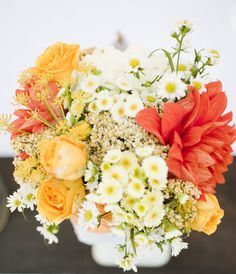 Love the color palette: yellows & oranges ~ of this centerpiece;)  Flowers by theflorallab.com, Photography by nancyneil.com