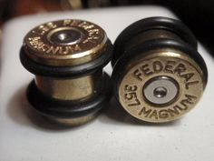 if I could pull these off I totally would. Bullet ear plugs 357 MAGNUM Bullet Plug Earrings.