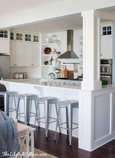 White Cottage Kitchen trimmed out support beam. Corbels. Raised bar.