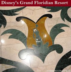 Pluto inlay in the marble floor in the lobby at Disney's Grand Floridian Resort.  For more resort photos, see: http://www.buildabettermousetrip.com/disneys-grand-floridian   #Pluto #GrandFloridian #Disneyworld #WDW