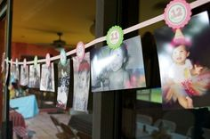 Tags on a ribbons line for photos of each month of the first year!