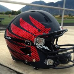 AMERICAN LEADERSHIP ACADEMY   Check out the helmets for the ALA Eagles in Utah with a matte black helmet and black facemask with red chrome carbon fiber chrome wing decals by Healy Awards.    Good luck this season!  Look great, play great!   #chromefootballhelmetdecals #chromefootballdecals #chromedecals #halfhelmetdecals #footballhelmetdecals #footballdecals #helmetdecals #helmetswag #uniswag #healyawards