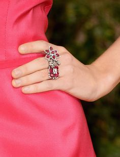 Taylor Swift accessorized her pink Carolina Herrera gown with a Lorraine Schwartz ruby and diamond flower cluster three ring.
