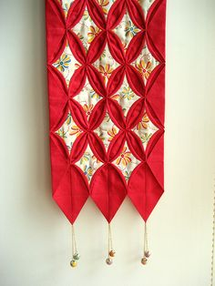 Cathedral Window Quilted Wall Hanging by STORY QUILT