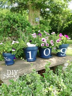 These house number flower pots would be adorable on the front steps or a bench in the front yard. Via DIY Show Off