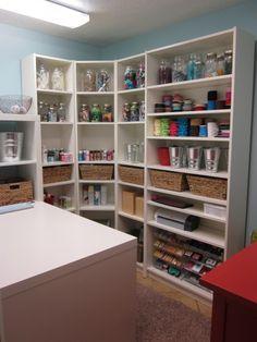 Organizing a craft room- I like how this shelf unit wraps around the corner!