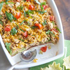 Tex-Mex Taco Dip - Try this flavorful taco dip at your next celebration, made from layers of ground turkey breast, cheese, refried beans, avocados, green onions, and chopped tomatoes.