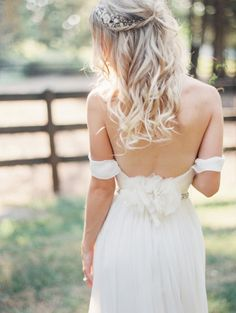 Boho off the shoulder wedding dress and long loose curls: http://www.stylemepretty.com/2014/07/22/wedding-dress-back-styles-we-love/
