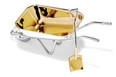 Sprinkle salt on your food out of this darling sterling silver wheelbarrow and shovel combo.