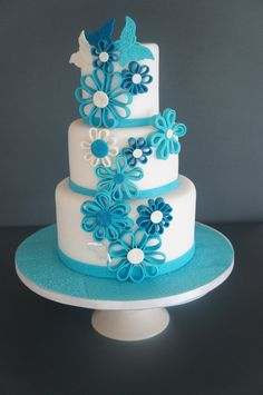 blue flowers -  The flower technique is called quilling is very simple you have to use pasta machine to have the same thickness of fondant.