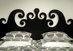Amazing headboard idea!  Just cut it out of wood and paint it.  Boom!
