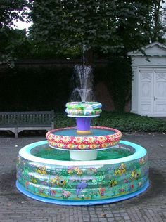 The Inflatable Swimming Pool Fountain...So cute ~ would be great at a backyard picnic or kids birthday party to use as a wishing well...where they could toss their pennies in and make a wish....fun idea for an outdoor bridal/wedding shower...I just love the Whimsy factor of this....deffinitely screams...Summer FUN