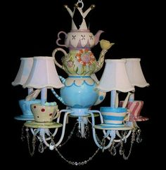 Mad tea party chandelier. Each cup and saucer represents a famous Wonderland charachter.