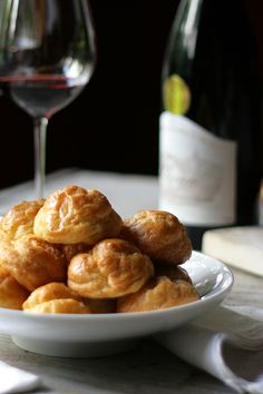 Gougeres - the perfect thing to go with all the red wine we will be drinking. This one adapted from Julia Child. food, red wines
