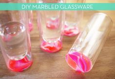 How To: Make DIY Marbled Glassware  Plastic Bottle  Water  Nail Polishes (several colors)  Nail polish remover  Tooth pick  Several glasses to color the bottom