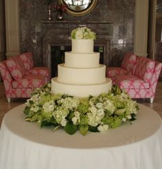 Wedding cake with new Lilly Pulitzer furniture in the background.