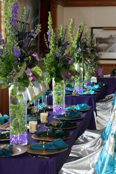 Nice Tablescape All you need is gold , maybe for the napkins & it will be Peacock & Mardi Gras Colors