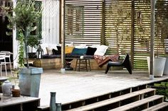 slatted outdoor privacy and wooden bench